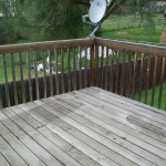 Natural-wood deck greyed out by sun damage